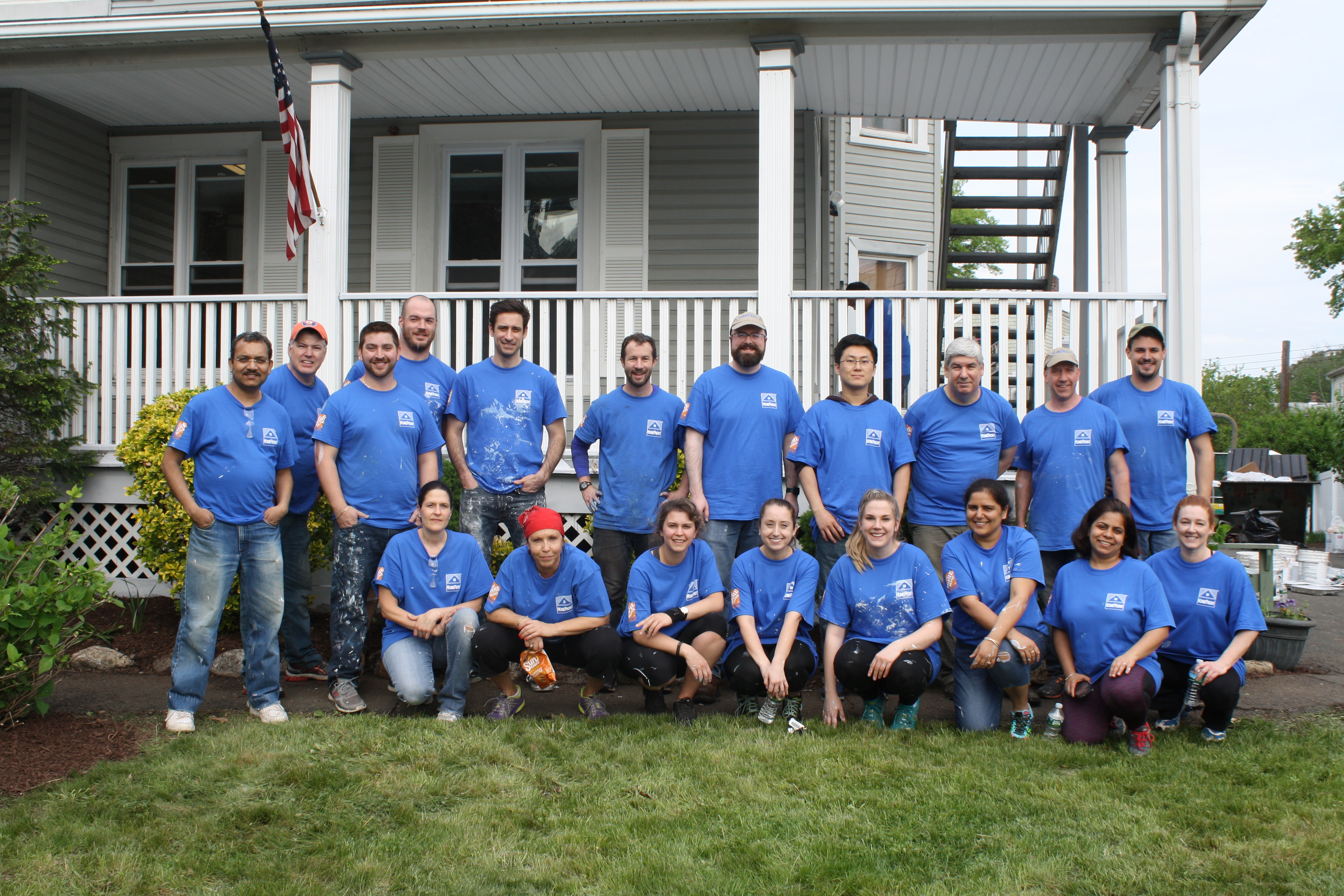 Volunteers at a Domus property for painting, construction, and gardening